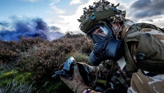 A member of 1st Battalion Scots Guards sets himself for a CBRN attack scenario on Ex SHADER TEMPEST as the Scots Guards carry out final preparations ahead of deployment on Op SHADER 121120 CREDIT MOD