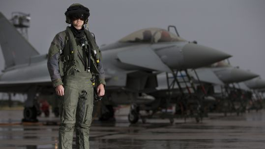 A pilot from 6 Squadron, RAF Lossiemouth in front of a line of Typhoon aircraft (Picture: Crown Copyright).