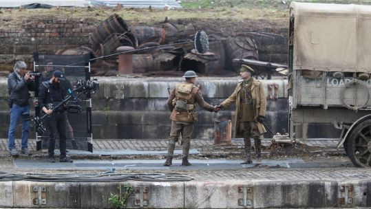Actors Mark Strong (right) and George Mackay on the set of Sam Mendes' new film 1917 during filming Credit PA Images 120619
