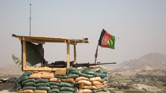Afghan flag flies over an observation post, Pekha Valley, Achin District, Nangarhar Province, Afghanistan.