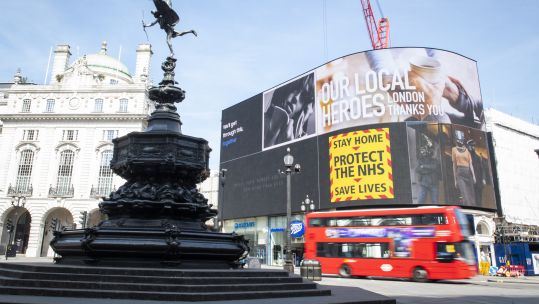 Cover image: An empty Piccadilly Circus during lockdown (Picture: PA).