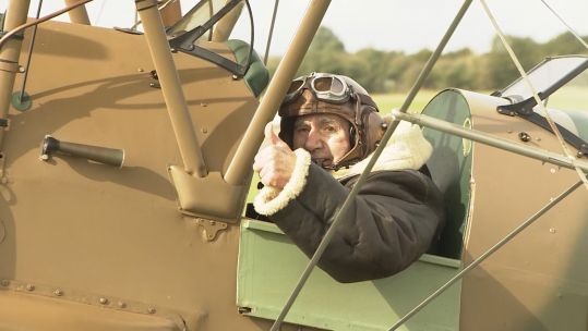 Anthony Hughes in a Tiger Moth biplane 101019 CREDIT BFBS
