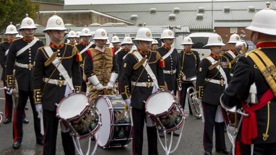 Bass Drummers of the Band Service of Her Majesty's Royal Marines wearing tiger skins