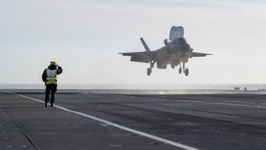 Cover Image: A British F-35B lands on HMS Queen Elizabeth in UK waters for the first time (Picture: HMS Queen Elizabeth/Twitter).