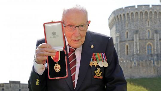 Captain Sir Tom Moore holding medal after he received his knighthood from Queen Elizabeth II during a ceremony at Windsor Castle (Picture: PA).