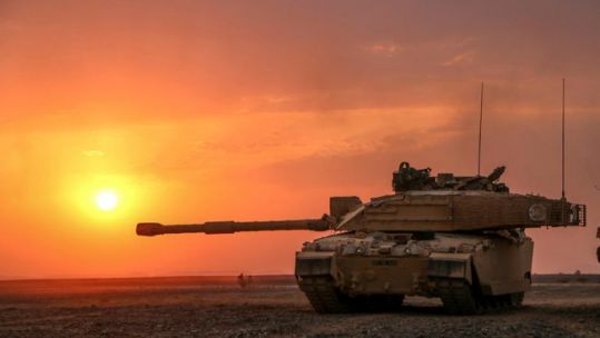 Cover image: Challenger 2 tank on exercise in Oman (Picture: MOD).