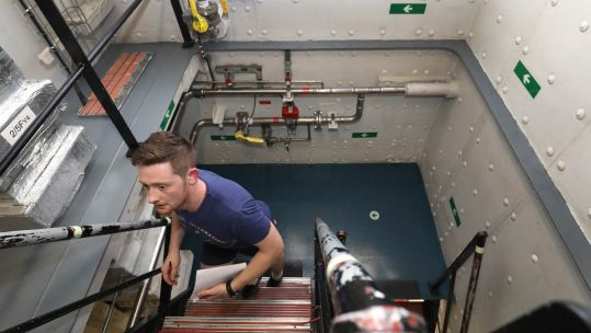 Cover image: Chef James Hopkinson climbs the stairs of HMS Queen Elizabeth (Picture: Royal Navy).