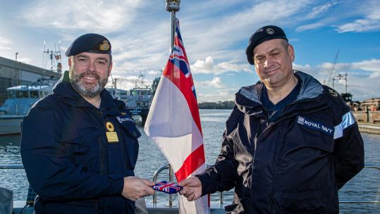 Cover image: Commodore Tim Neild presenting the LSA5K award to LS John Gibson on board HMS Magpie (Picture: Royal Navy).