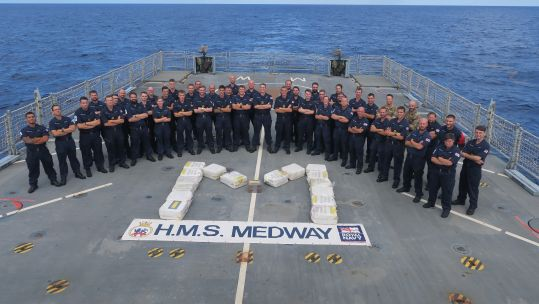 Crew of HMS Medway with the cocaine they seized in the Caribbean, which came as one of three interceptions with an estimated £81m of cocaine seized