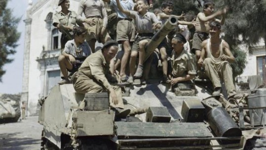 Children on a Sherman Mk III tank in Sicily in WWII