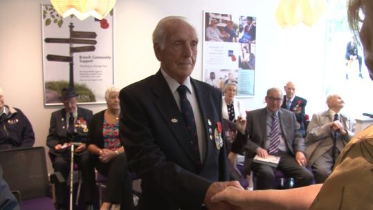 Veteran Fred Hill receives his Legion D'honneur medal during the event.