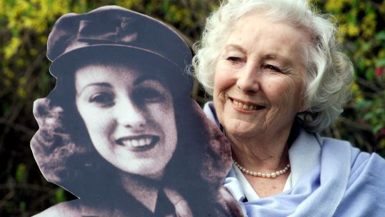 Dame Vera Lynn with life-size cutout of herself after being named personality of the century (Picture: PA).