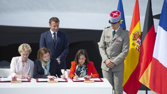 Emmanuel Macron with Ursula von der Leyen, Florence Parly and Margarita Robles sign a deal at Paris Air Show 170619 CREDIT PA