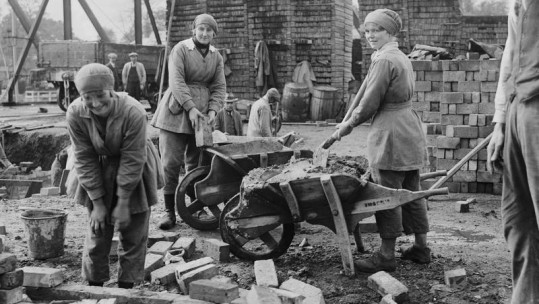Female bricklayers on building site during WWI