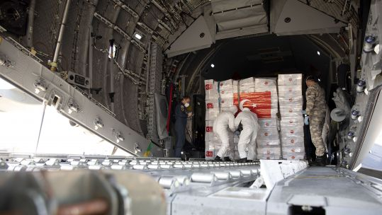 Forces personnel unload a previous delivery of equipment from Turkey at Brize Norton earlier this month (Picture: MOD).