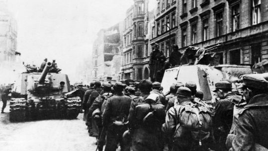 Cover image: German soldiers are captured by Russian forces at the end of the war in Berlin, a week before VE Day (Picture: PA).