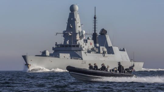 Cover Image: HMS Defender and its detachment of Royal Marines travelling in a sea boat (Picture: Royal Navy).