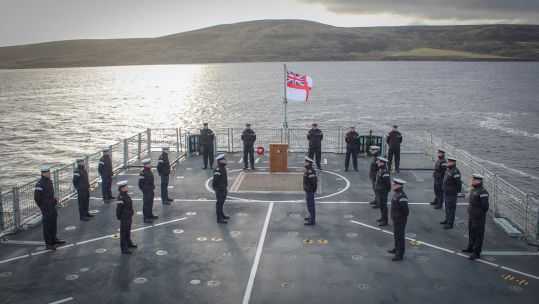 HMS Forth company holds commemorative service for Falklands heroes near HMS Antelope wreckage (Picture: Royal Navy).