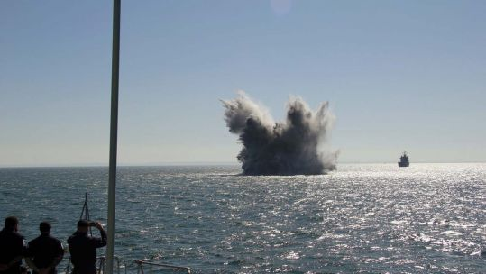 Cover image: HMS Grimsby detonates a mine (Picture: Royal Navy).