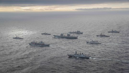HMS Queen Elizabeth during Exercise Joint Warrior surrounded by other vessels as Carrier Strike Group forms