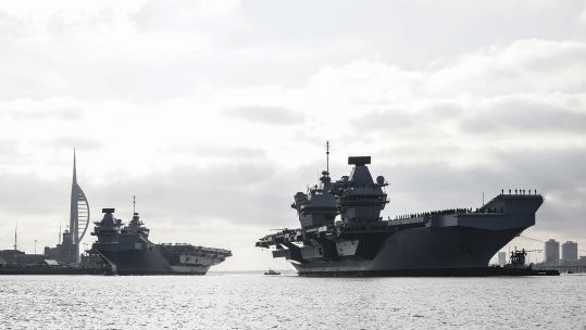 HMS Queen Elizabeth sails past HMS Prince of Wales (Picture: Royal Navy).