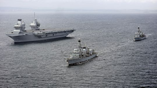 Aircraft carrier HMS Queen Elizabeth sails alongside two Royal Navy frigates (Picture: MOD).