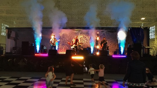 CSE Band Minibar Disaster perform on stage at the RAF Benson Hangar Party