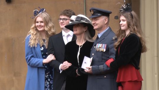 Investiture at Buckingham Palace Wing Commander Sebastian Kendall with his family 191219 CREDIT BFBS