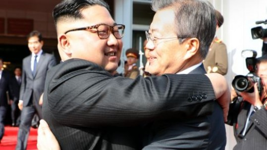 The two Korean leaders embrace as they meet for a second time in a month (Picture: PA).