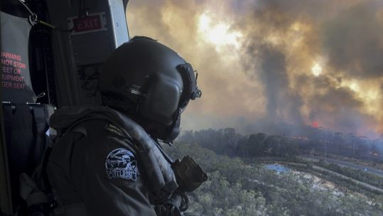 Lieutenant Commander Nick Grimmer looking at Australia fires