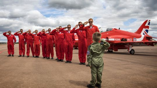 five year old Jacob salutes red arrows
