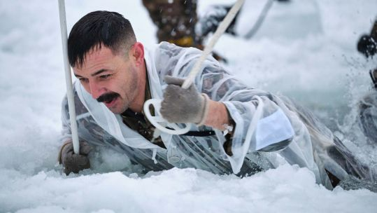 Royal Marine takes on ice breaking drills in Norway