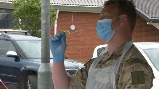 Member of 29 Commando Regiment shows how to use self testing kit at CORONAVIRUS COVID19 mobile testing unit in Bude