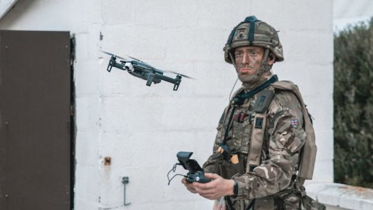 Cover image: Royal Marine flies a drone (Picture: Royal Navy).