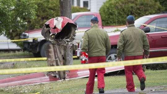 Cover image: Members of the Canadian Forces Snowbirds at the scene of the crash in Kamloops (Picture: PA).