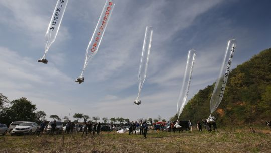 Members of Fighters for Free North Korea, an organisation of defectors from North Korea, send balloons carrying anti-North leaflets across the border from the South Korean border city of Paju