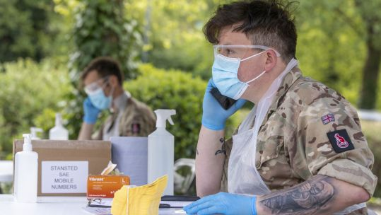 Members of Royal Anglian Regiment speak on the phone at Hemel Hempstread COVID19 Coronavirus mobile testing centre (Picture: MOD).
