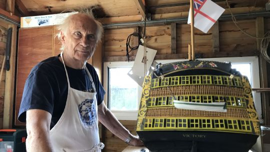 Michael Byard with his completed model of HMS Victory which took him 41 years 070820 CREDIT BFB
