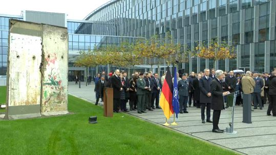 A ceremony was held around the Berlin Wall Memorial, outside NATO headquarters (Picture: NATO TV).