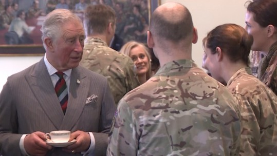 Prince Charles takes tea with NATO troops at AARC base