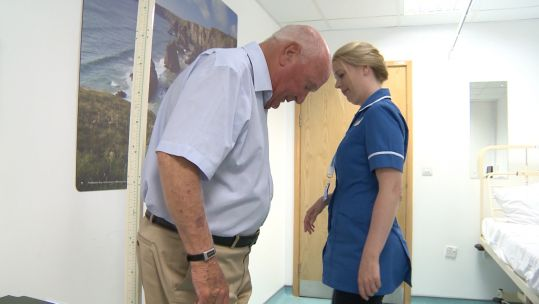 Nurse Helen Wilkes with RAF veteran patient.