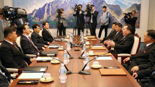 Officials from the Koreas speak at Panmunjom (Picture: PA).