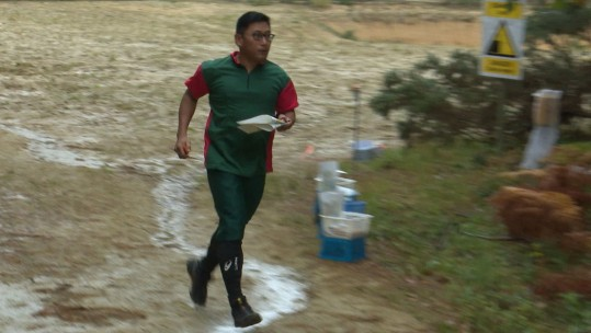 An orienteer competing in the Military League South in Hawley, Surrey.