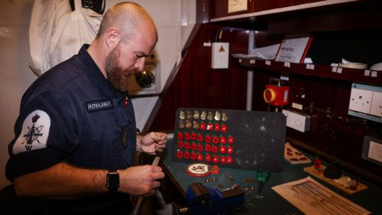 PO Andy Kirkaldy turning shell casings into poppies for shipmates on HMS Sutherland 261020 CREDIT ROYAL NAVY