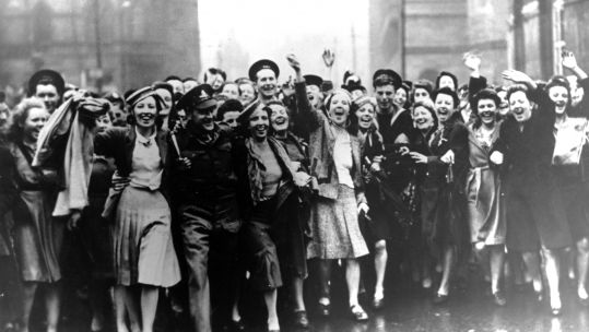 People celebrate VE Day in Manchester in 1945 (Picture: PA).