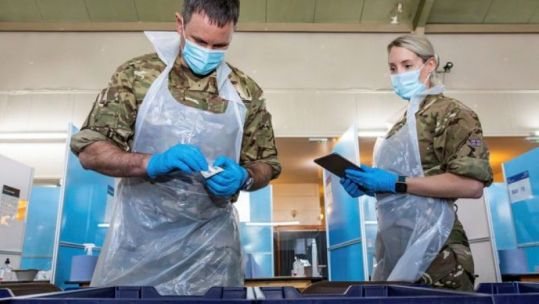 Personnel assisting with coronavirus testing at Gresley Old Hall, Derbyshire (Picture: MOD).