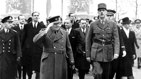 Prime Minister Winston Churchill (l) and General Charles de Gaulle walk down the Champs Elysees after the liberation of Paris (Picture: PA images).