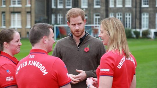 Prince Harry talks with Team UK members at launch