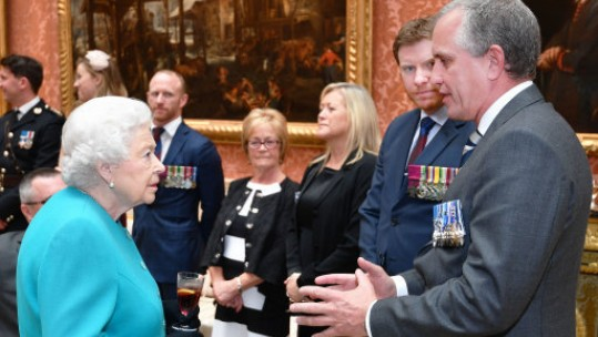 Queen talks to Troulan