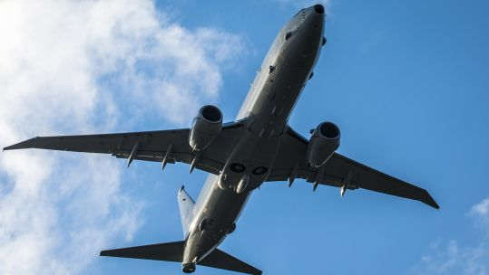 RAF new P-8A Poseidon aircraft from below in the skies over NAS Jacksonville (Picture: MOD).